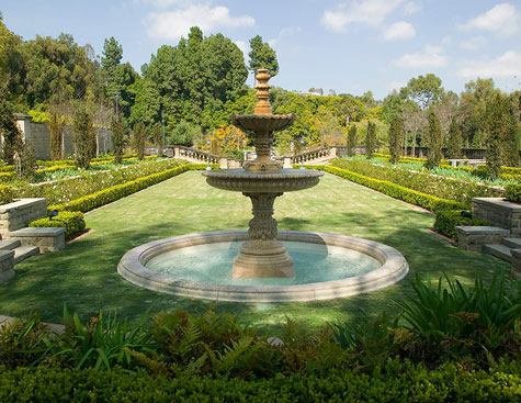 green gardens and stone fountain at the greystone mansion in beverly hills, california
