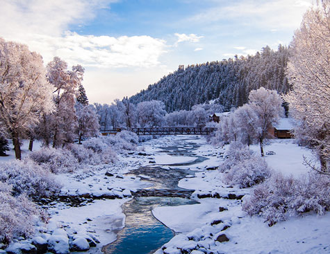 snow-filled scene of the san juan river in pagosa springs, colorado.
