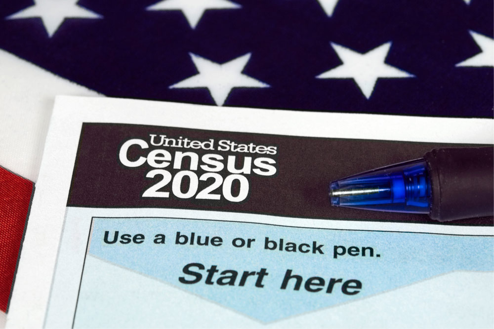 U.S. 2020 census form with a part of a U.S. flag as the background image.