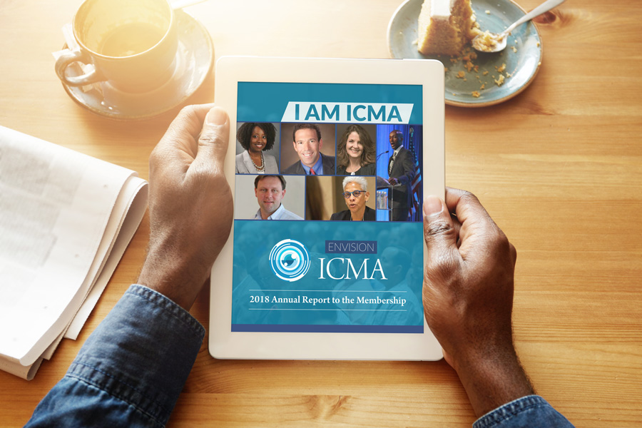 Photo of a man viewing the ICMA annual report on a tablet