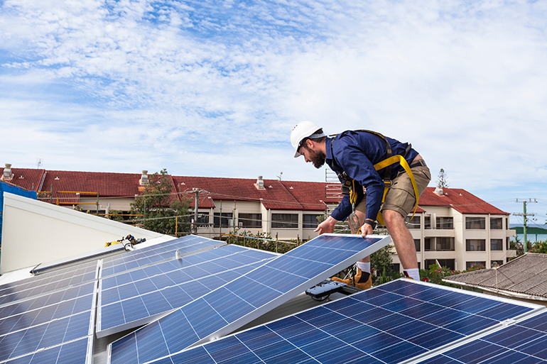 Photo of a solar panel technician