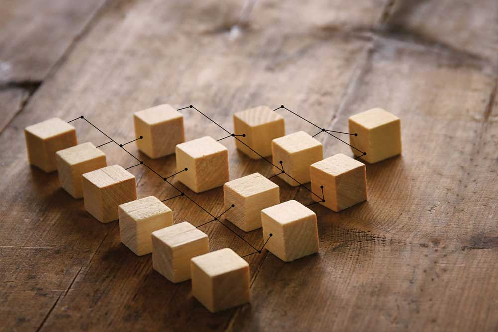 small wooden blocks connected to represent a hierarchy