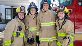Firefighter Sandy Dostal, Excelsior Councilmember Lou Dierking, Tonka Bay City Administrator Kathy Laur, and Fire Marshal Kellie Murphy-Ringate
